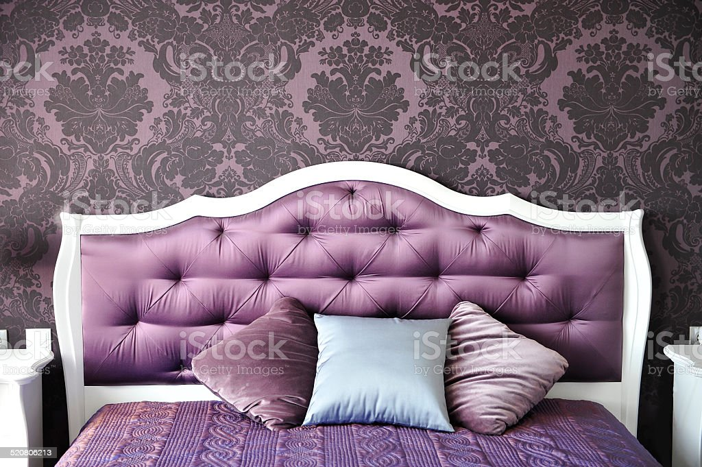 purple bedroom interior,  luxurious bed. stock photo