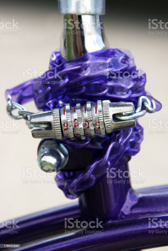 Purple bicycle combination chain lock royalty-free stock photo