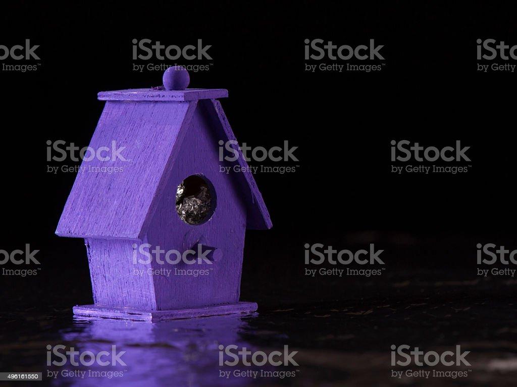 Purple Bird Boat House stock photo