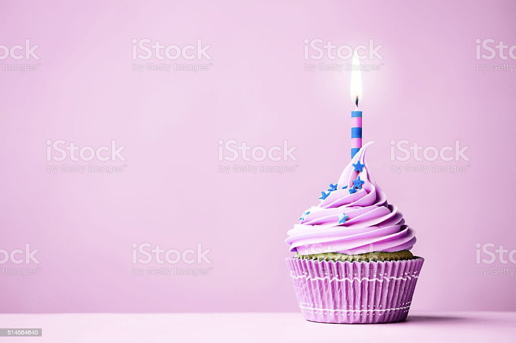 Purple birthday cupcake stock photo