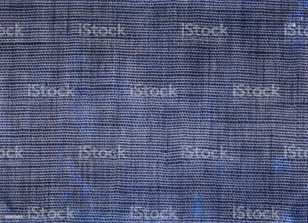 Purple blue colored plain fabric background stock photo