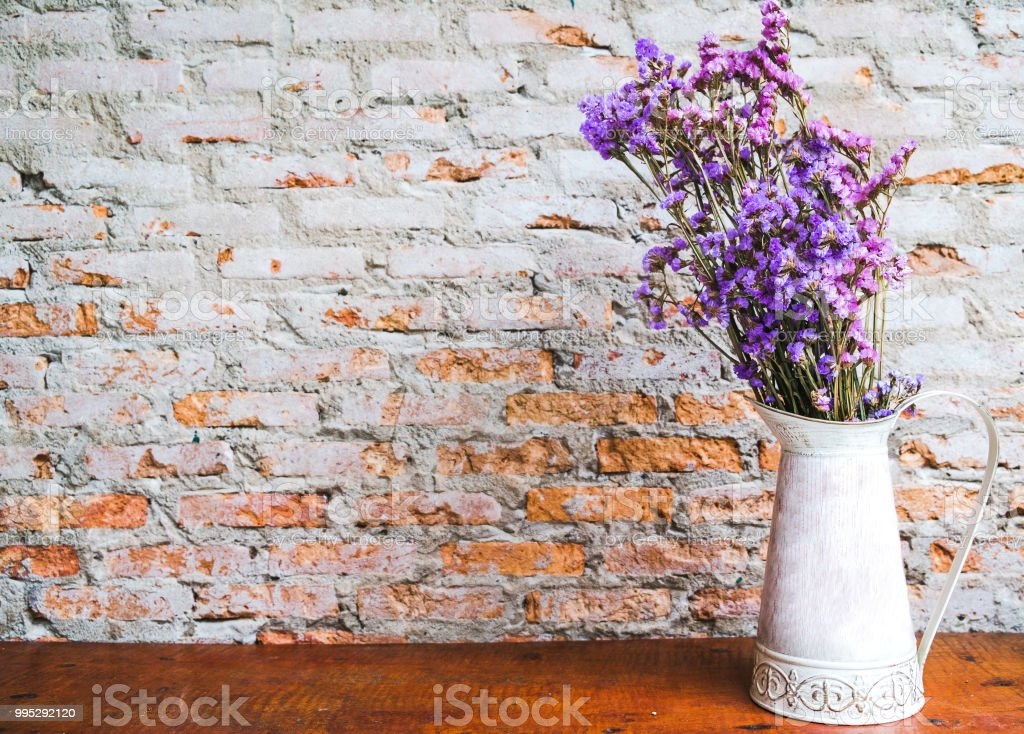 Purple Bouquet Of Dried Flowers In The White Jar Stock Photo