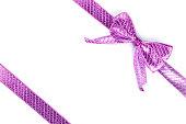 istock Purple bow tied using silk ribbon 886978680