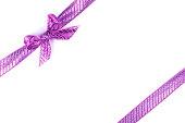 istock Purple bow tied using silk ribbon 886978710