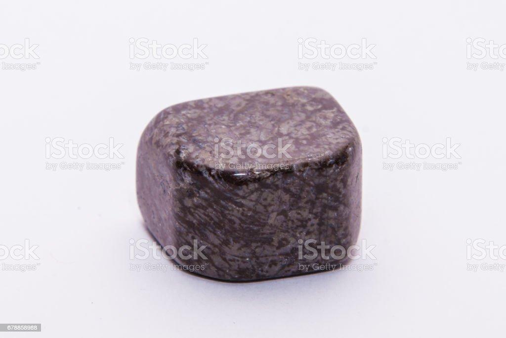 Purple brown striped gemstone gem jewel mineral precious shiny stock photo