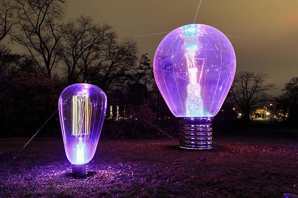 glow purple bulb - eindhoven city stockfoto's en -beelden