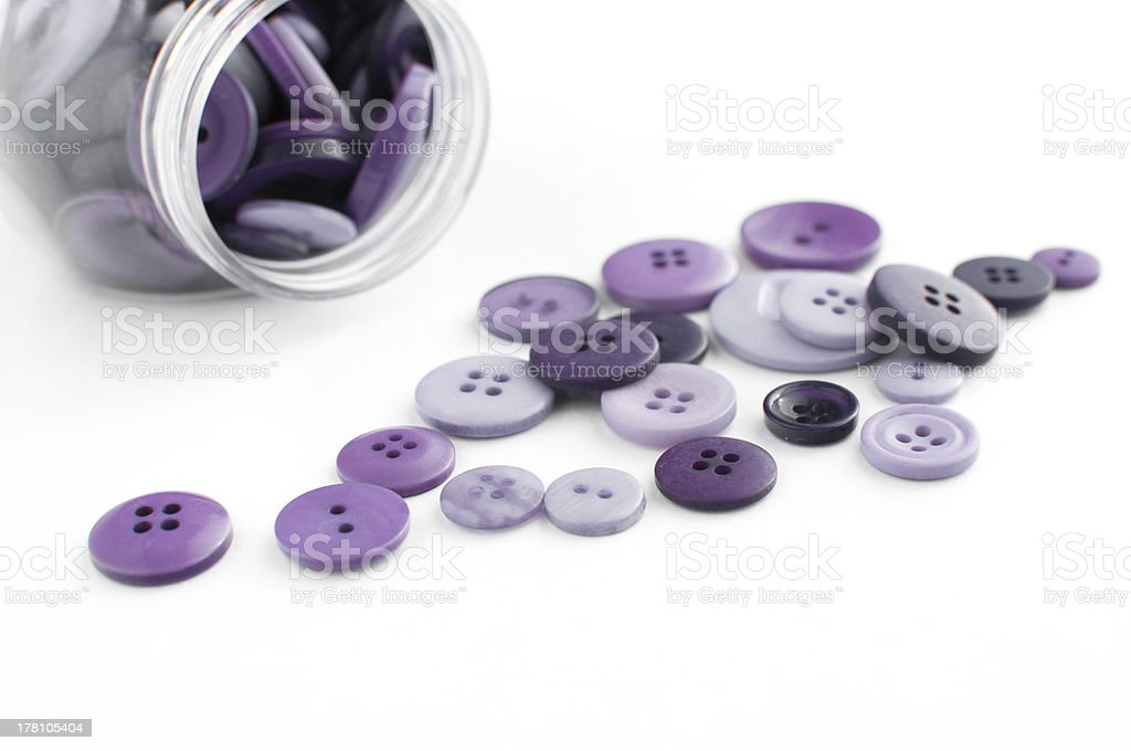 Purple buttons spilled from jar royalty-free stock photo