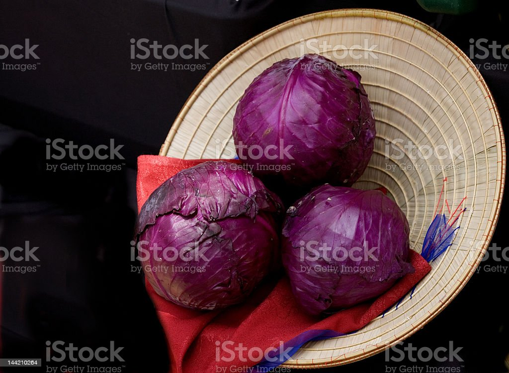 Purple Cabbage in a Straw Hat royalty-free stock photo