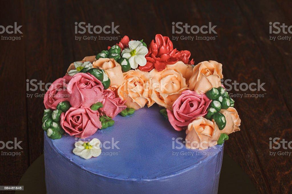 Purple cake with cream flowers stock photo