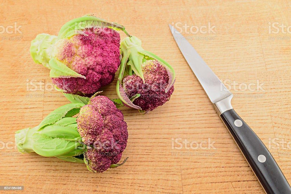 Purple cauliflower and knife stock photo