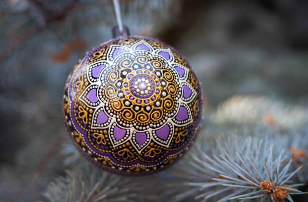 Purple christmas ball on pine tree stock photo