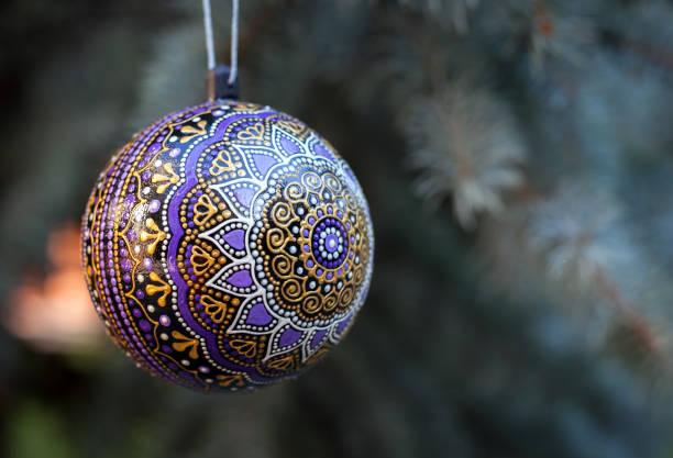 Purple christmas ball with painted mandala stock photo