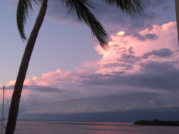 Purple Clouds at dusk over the Gulf of Mexico stock photo