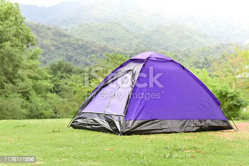 Purple color dome tent in mountain range landscapes.