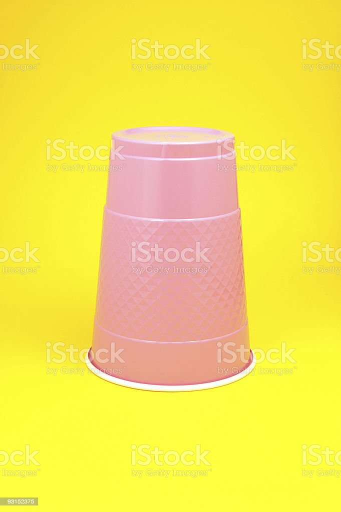 Purple Cup on a Yellow Background stock photo