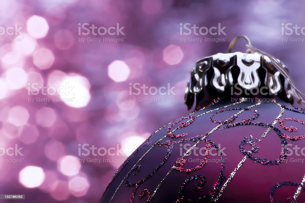 Purple decorated Christmas ball on a purple background royalty-free stock photo