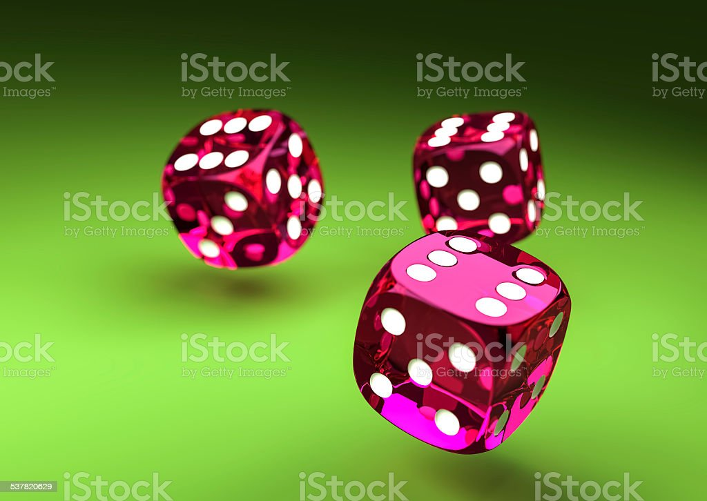 Purple Dice on green table stock photo