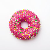 istock Purple donut in glaze on a white background. Great fresh tasty purple donut drizzled with glaze 927857330