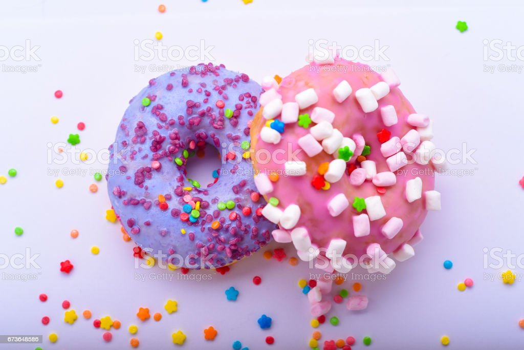 Purple Donut With Chocolate Sprinkles Stock Photo - Download
