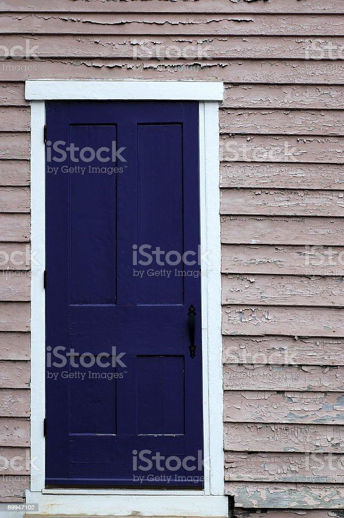 Purple Door, Pink Wall royalty-free stock photo