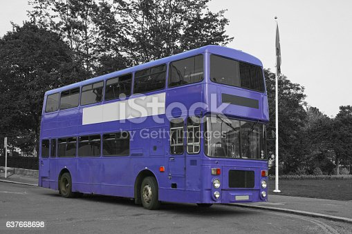 A purple double-decker bus isolated on a black and white background.