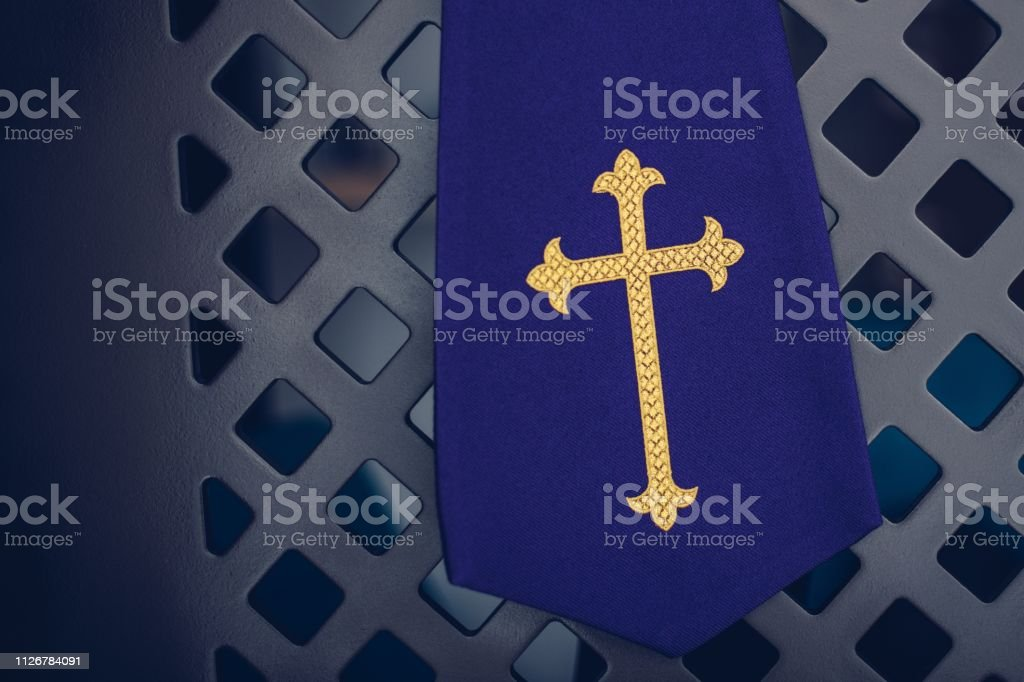 c024c277b9 Purple Fabric Stole In Confessional In Church Stock Photo - Download ...