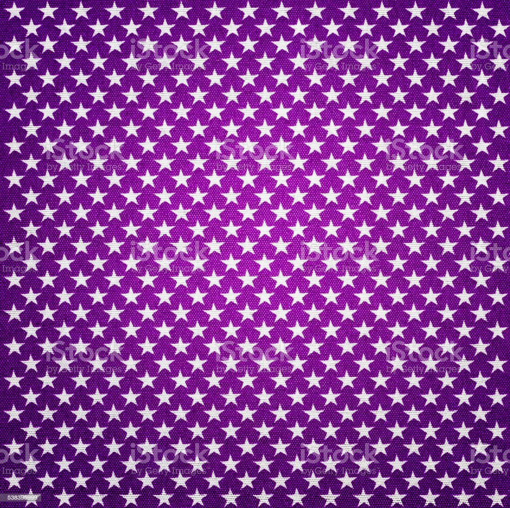 Purple fabric with white stars with vignette effect stock photo
