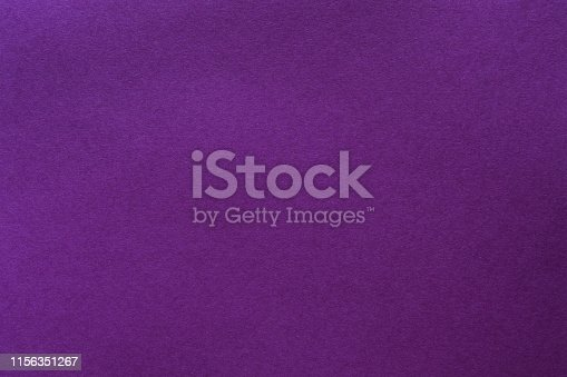 Purple felt texture abstract art background. Solid color wool textile. Empty space.
