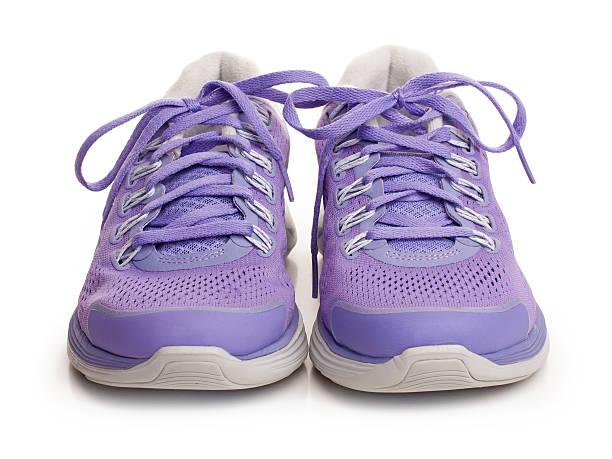 Purple female sport shoes stock photo