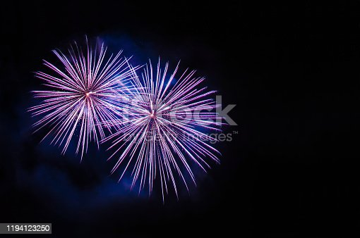 969086552istockphoto Purple fireworks with negative space, copy space 1194123250