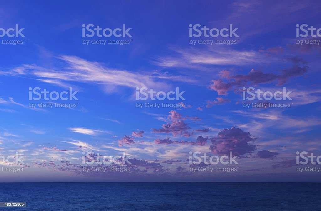 Purple floating clouds above the Indian Ocean stock photo