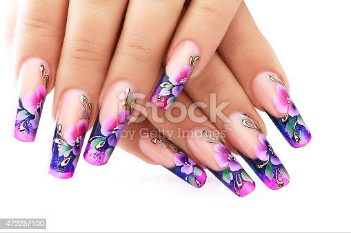 istock Purple floral design on long fingernails 472257100