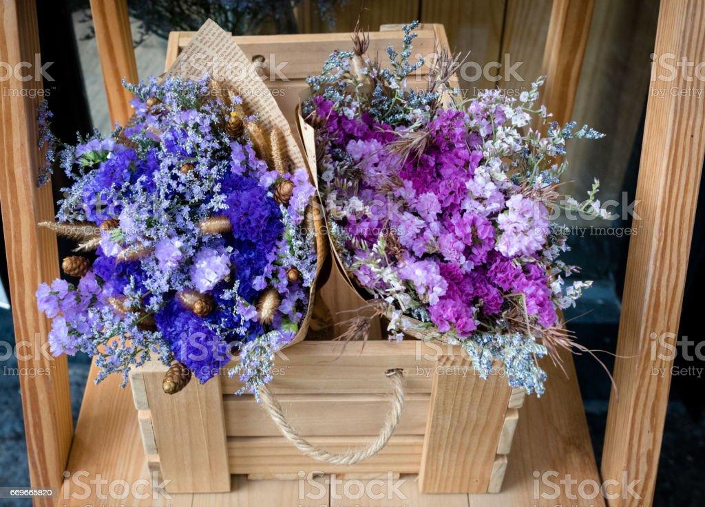 Purple Flower Bouquet And Blue Flower Bouquet In A Wooden Box Stock ...