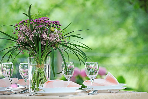 purple flower table centerpiece - garden party stock photos and pictures