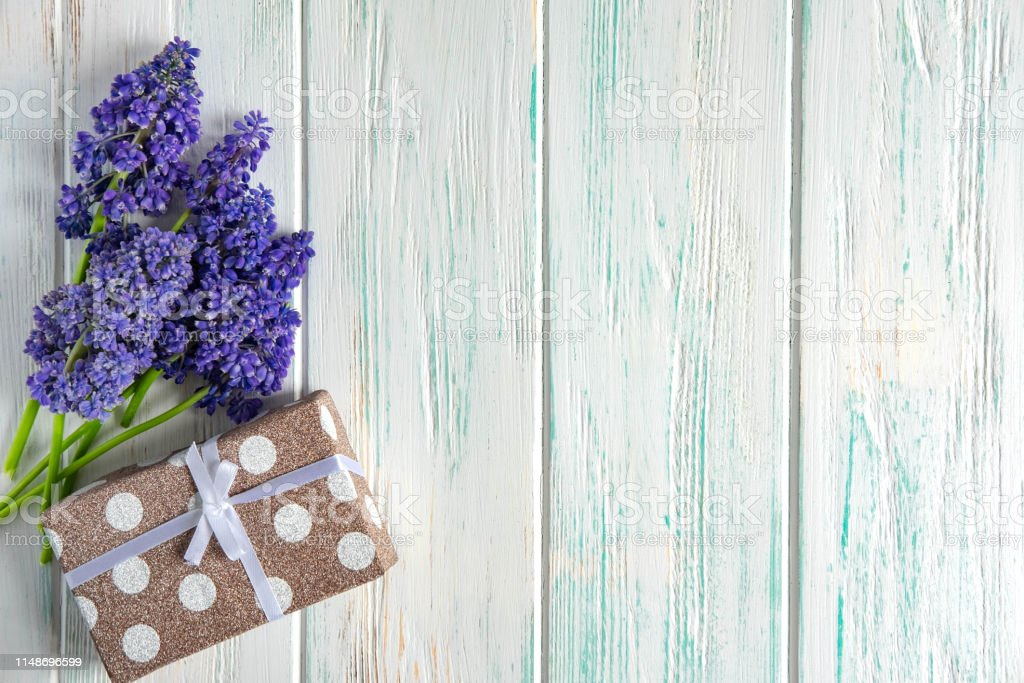 Banner with flowers of purple color, gift and place for greeting...