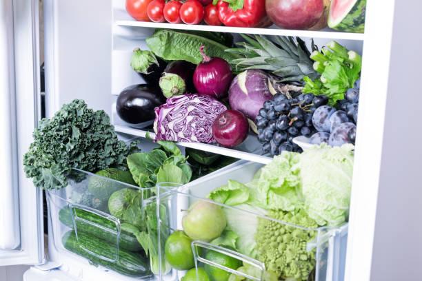 Purple fresh vegetables in refrigerator stock photo