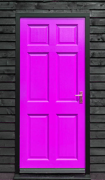 Purple Front Door In A Black Wall Stock Photo More Pictures Of