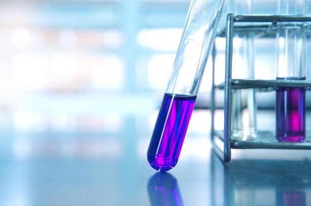 purple glass test tube and metal rack  in medical experiment science laboratory background stock photo