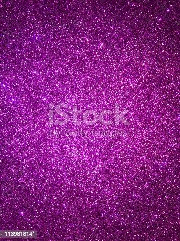 887762464 istock photo Purple glitter 1139818141