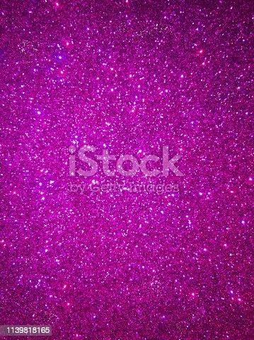 887762464 istock photo Purple glitter 1139818165