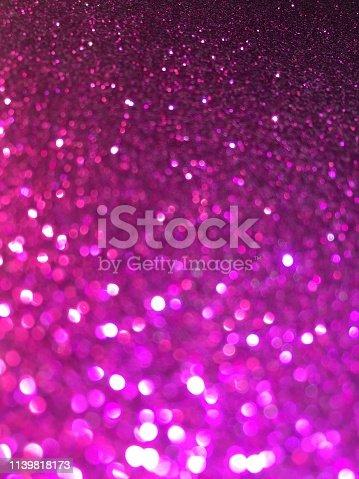 887762464 istock photo Purple glitter 1139818173