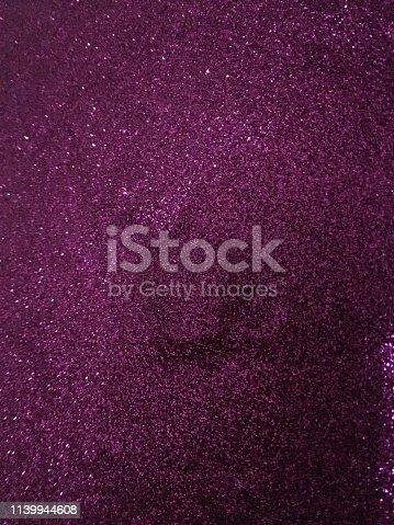 887762464istockphoto Purple glitter 1139944608