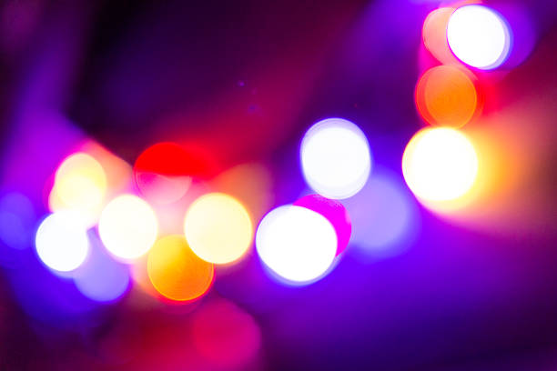 Purple glitter vintage lights background, defocused stock photo