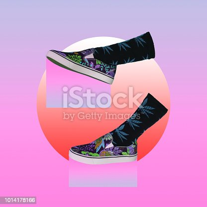 1014178164 istock photo Purple gradient color dripping from the sole of the sneakers. 1014178166