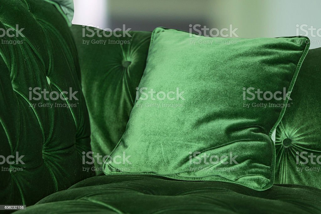 Purple green pillows on the sofa stock photo