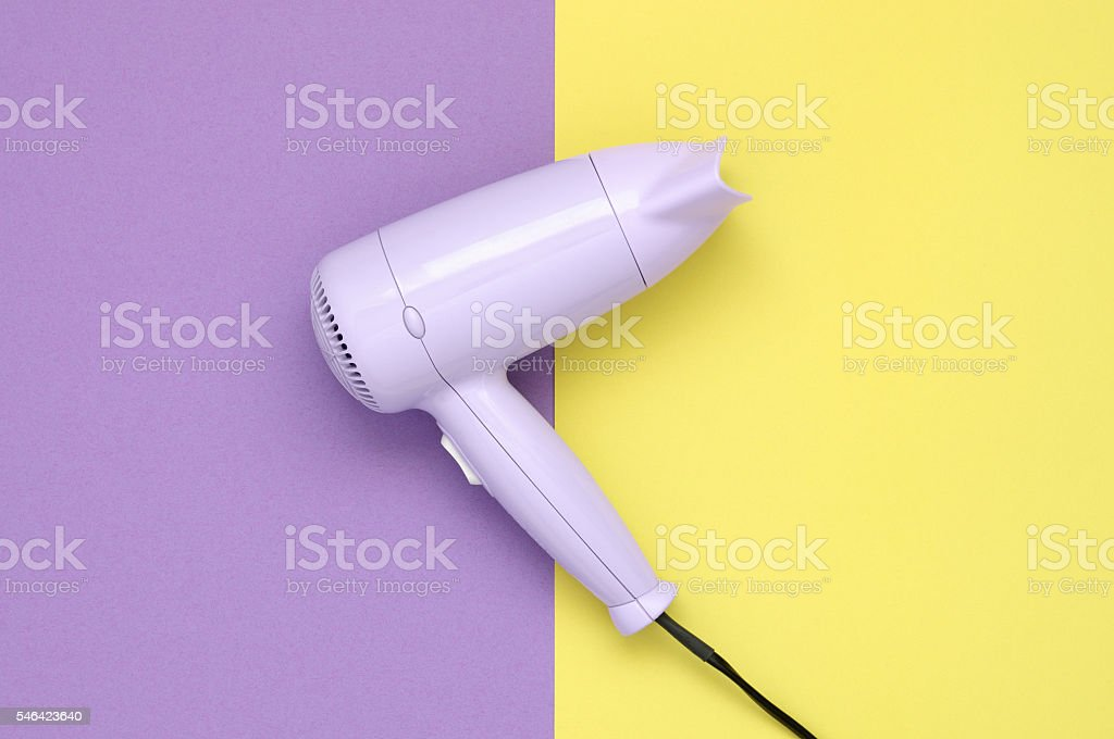 Purple hair dryer on purple and yellow background – Foto