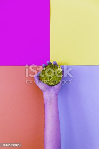 1014178170 istock photo purple hand holding a crystal 1002083520
