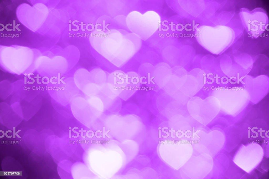purple heart bokeh background photo, abstract holiday backdrop stock photo