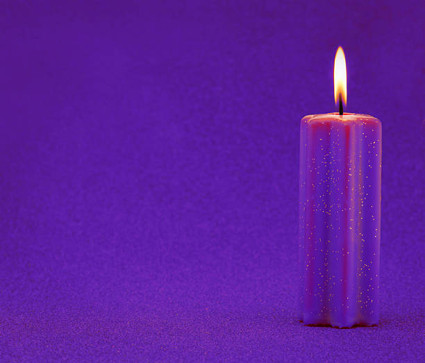 Purple holiday candle with glitter background stock photo