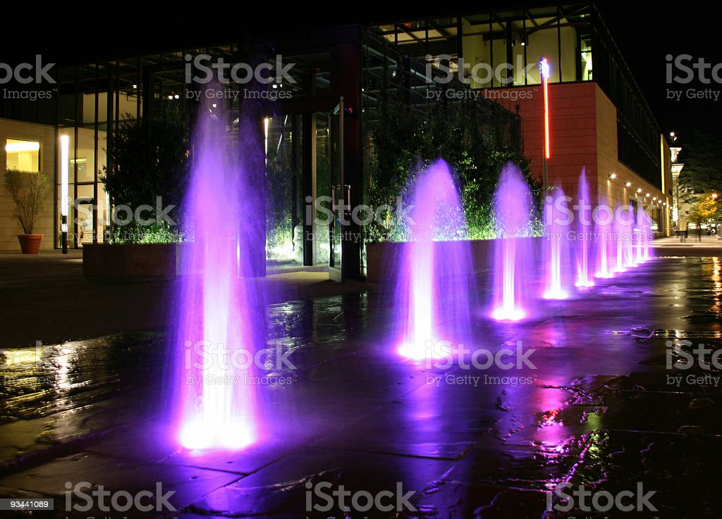 Purple Illuminated Fountains By Night royalty-free stock photo